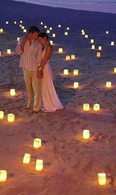 This is a good idea for most outdoor weddings. I can't tell if these are all glass, but using luminarias or even batter operated candles (if using these, put inside a jar, because they never fool anyone) would give the same effect