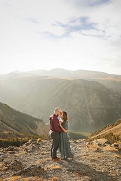 Fall Engagement Session - Red Lodge - Montana - Beartooth Pass - Beartooth Highway - Man - Woman - Engaged - Couple - Fiancé - Outdoor - Overlook - Mountains - Trees - Rocks - Maroon Dress Shirt - Burgundy Dress Shirt - Gray Pants - Gray Jeans - Blue Dress - Teal Dress - Sunset - Montana Wedding Photographer - Sara Nagel Photography