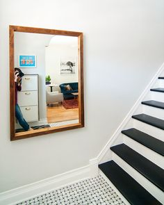 If you're looking to DIY a similar frame – whether it's to repurpose a mirror or display your art collection – old framework like this can often be found at your local Habitat for Humanity ReStore or any architectural salvage shop. At the same time, you can make your own frames using new lumber all the same! diy reclaimed wood mirror finished