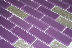 A calming mix of glossy and frosted purple subway tiles is jazzed up with metallic pearlescent silver tiles in this custom #design    #designer #designideas #inspiration #purple #glitter #style #instastyle #instagood#instahome #backsplash #sparkle #shine #home #homedecor #homedesign #diy #interiordesign #interiorstyling #interior4all #interiordecor #interior123 #interiordecorating #remodel #renovate #homeimprovement #architecture #decor #deco #tile
