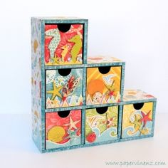 """Fun """"Beach House"""" style project with a full color tutorial showing you how to make glossy embellishments from recycled ceral boxes!"""