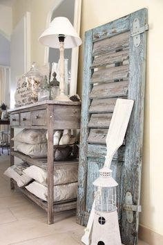 Decorating with Shutters vintage shutter decor leaning on wall.love the rustic beach house decorvintage shutter decor leaning on wall.love the rustic beach house decor Beach Cottage Style, Beach Cottage Decor, Coastal Decor, Coastal Interior, Coastal Living, Coastal Cottage, Coastal Style, Coastal Bedrooms, Trendy Bedroom
