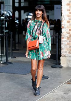 woman wearing a minidress and ankle boots