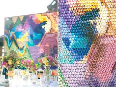 Chicken wire filled with colored paper? But instead of crumpling the paper up like you would on a float or a wall decoration it's rolled and secured, probably by painting the chicken wire with glue or modge podge then sticking the paper in.