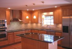 Like color combos with granite and tile backsplash