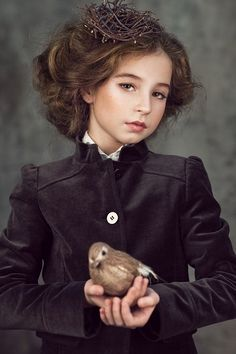 I am the young daughter of the Duke. When I grow up, he says, I will be a great lady. I will command many servants and will have whatever I want. I am an heiress, so I have been engaged quickly to a Lord many miles away. I hope that I catch fever though. It took Mamma away, so maybe it will take me too. Then we can sit on our thrones of clouds and laugh at the silly world as we used to.