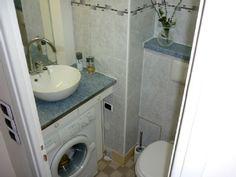Location vacances appartement Saint Philippe: La Toilette avec lavabo et lave-linge
