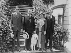 Black and white photo of President and Mrs. Coolidge standing on steps, with their two sons, John Coolidge and Calvin Jr, and their pet dog, June President and Mrs. Coolidge With Their Sons and Dog. This image is available as a print. Presidents Wives, American Presidents, Republican Presidents, Black Presidents, Us History, American History, Family History, Presidential History, Presidential Trivia