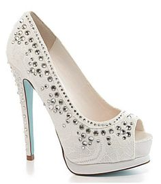 """If you are getting married this spring or summer this is perfect shoe for you! It comes from """"Blue"""" collection by Betsey Johnson and features ivory satin lace with crystals all over the shoe. This peep toe also have your something blue which would be the blue bottom sole!"""