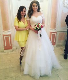 Off the shoulder plus size wedding dresses with short sleeves and a tiered skirt can be recreated for you with any changes you need. We are in the USA and provide brides with affordable custom wedding dresses & #replicas of haute couture bridal gowns. Get pricing on plus size wedding dresses made specific to you on our site.