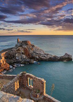 Church of San Pietro in Portovenere and mullioned window of the castle at sunset. Italy