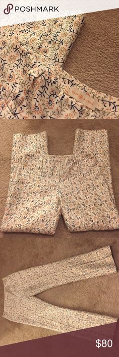 Tory Burch floral pants! Beautiful pair of Tory Burch pants! Main cream color with orange, green, and black floral print. Two front pockets, two back pockets, and belt loops. Worn only a few times! Size 0. Inseam 28. Smoke free home. Tory Burch Pants
