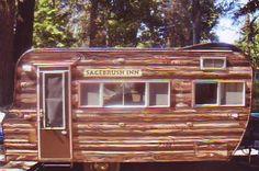 Sagebrush Inn Log home look vintage travel trailer