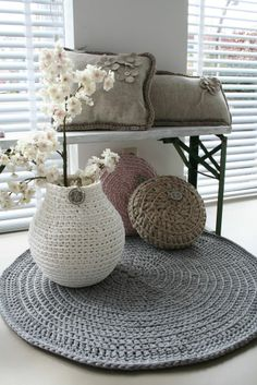 crochet rug, vase, pillows and cushions...
