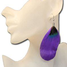 Wholesale feather earrings, feather earrings wholesale.  The feathers are attached to the earring fishhook with a small silver spiral like design. They come in 8 solid colors with the dark top. We have them in Lime Green, Purple, Black, Hot Pink, White, Red, Canary Yellow or Teal. They are a very nice feather earring at our wholesale price of only $1.00 each pair.