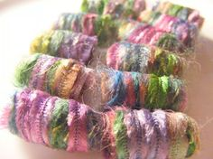 fiber beads in gorgeous colors - make jewelry, decorate a scarf, highlight your dreads. on etsy.
