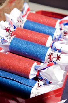 Use fun scrapbook paper and tissue paper to roll up candies and small toys as favors for your party.