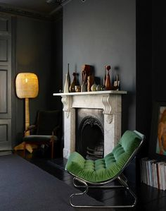 Eclectic Living Room with Cy Mann Chrome Lounge Chair, Natural rattan weaving bowling design floor lamp, stone fireplace Modern Victorian, Victorian Homes, Decoration Inspiration, Interior Design Inspiration, Dark Interiors, Beautiful Interiors, Dark Walls, Grey Walls, Piece A Vivre