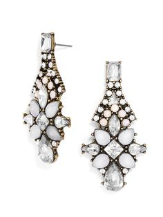 Shades of white on these elegant gem-encrusted drops evoke the soft silhouettes of the Austrian flower--iridescent blush stones add another dimension to this feminine pair.
