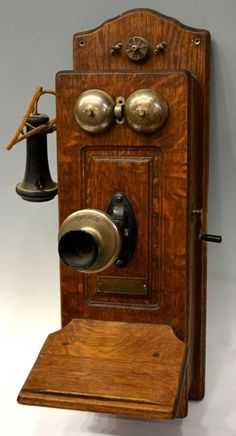 """I love this piece.  Antique Oak Cased Crank Telephone: Oak cased winding crank wall telephone, c. 1900, metal plate marked """"Chicago Telephone, Supply Company, Elkhart, Indiana, U.S.A."""",mouthpiece marked Chicago"""