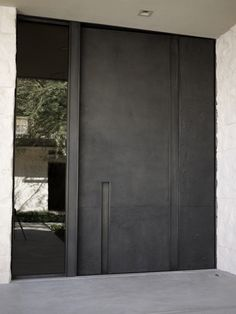 Steel Offset Pivot Entry Door with glass panel by Mc Nae Design
