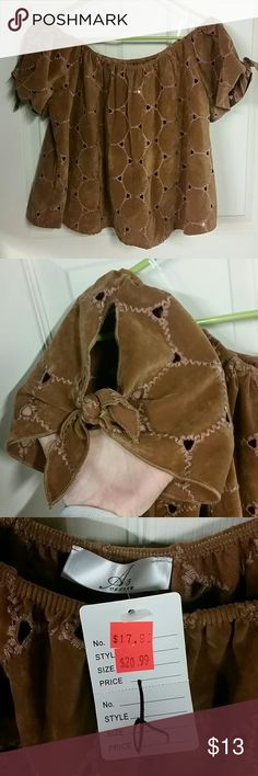 """Suede like patchwork off the shoulders crop top L Really cute top. Super soft microfiber like material. Feels like suede. Almost has a native american feel to it. Looks super cute over a tank top or bralette. Has 2 clear straps to hold it up on shoulders. Sleeves are slitted with ties Bust laying flat 22""""  Length from top to bottom 17"""" Very stretchy material, can fit up to xl, or 2x  Victorian, romantic, boho, coachella,  bonaroo, grateful dead, phish,  bohemian, Hippie, festival, country…"""