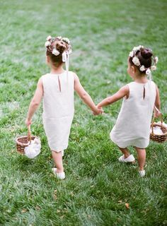 Adorable flower girls holding hands: http://www.stylemepretty.com/2016/08/26/classic-elegant-duke-mansion-wedding/ Photography: Almond Leaf Studios - http://almondleafstudios.com/
