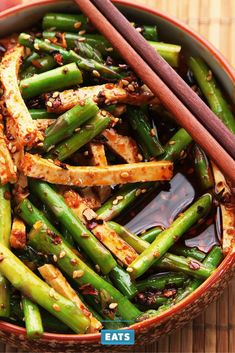 Asparagus isn't a traditional Chinese ingredient, but that shouldn't stop you from pairing it with Chinese flavors. Here, we dress blanched asparagus and tofu matchsticks in the same fiery hot-and-sour sauce we use for our Sichuan-style wontons.