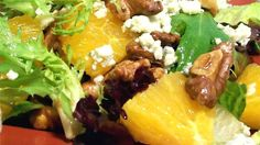 This summery salad is made with salad greens, fresh oranges, red onions, glazed walnuts, and Gorgonzola cheese, then topped with a homemade citrus vinaigrette.