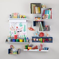 The paper holder and ledge shelf could be great in the closet. I also like using the paper holder to hold washi tape and spools of ribbon as shown here. We could stick with all white for these pieces and bring the color in via the craft supplies.