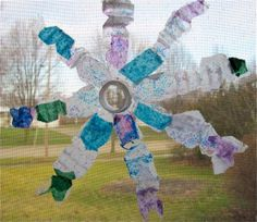 """water bottle snowflakes kids craft - could also be a """"flower"""""""