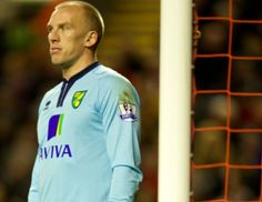 Norwich keeper John Ruddy looks on