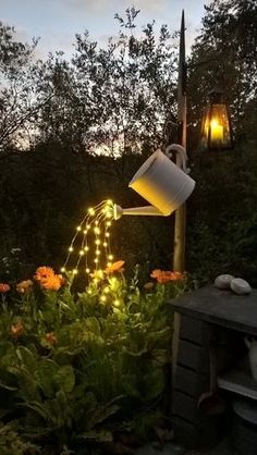 Today we have a beautiful outdoor DIY project to share with you. This glowing watering can with lights is so beautiful and SO easy to make! Pick a special spot in your garden or yard (maybe even your fairy garden) where you'd like to hang these glowing lights pouring from a watering can. It's gorgeous and unique! To make a glowing watering can with lights that look like they are pouring water, you will need the following supplies (the proper lights can be hard to find, but keep checking on…