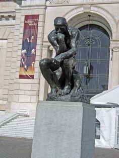 """""""The Thinker"""" by Auguste Rodin. Bronze and granite sculpture. Detroit Institute of Art 5200 Woodward Avenue in Detroit's Cultural Center. Installed November 21, 1983."""