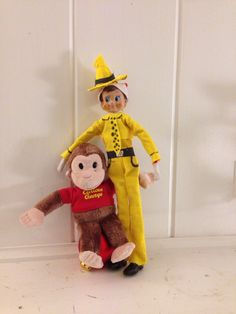 elf on the shelf dressed as Ted, Man with the Yellow Hat from curious George.