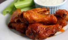 BUFFALO WINGS: The city of Buffalo, New York, hosts a Buffalo Chicken Wing Festival every Labor Day weekend, to celebrate the idea born in 1964 to toss chicken wings in cayenne pepper hot sauce and butter. Wing Recipes, Real Food Recipes, Snack Recipes, Greek Marinated Chicken, Buffalo Recipe, Cooking With Beer, Buffalo Wings, Best Dishes, Food Dishes
