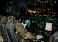 The pilot of a Royal Air Force C-130 Hercules guides the transport aircraft into Kabul Airport, Afghanistan.