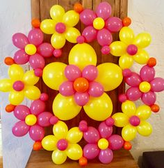 "Balloon wreath in pink, yellow & orange. Great for a Fiesta, girl's birthday or Spring/Summer event! Big 48"" diameter, can hang from ceiling."