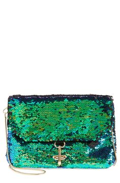 Swooning over this emerald green sequin clutch!