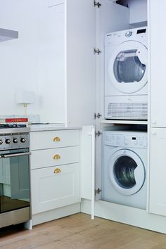 Hidden washer and dryer in kitchen of Isabel and George Blunden London renovation | Remodelista