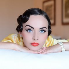 Granted, she is air brushed like crazy, but it is still a gorgeous porcelain pin-up look.