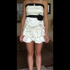Beautiful party dress City triangles ivory  and black super soft great condition. Black waist belt bow ties in back. City Triangles Dresses Mini