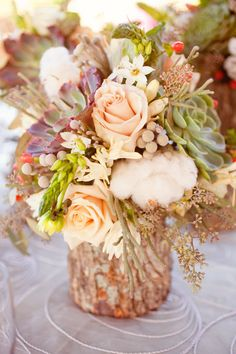 Tree stump floral arrangements with succulents.