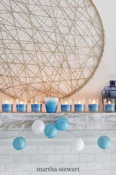 Celebrate the Festival of Lights with this DIY menorah made from glass votives or small jars. Make this holiday craft to add some warmth and cheer to your space! #marthastewart #crafts #diyideas #easycrafts #tutorials #hobby Hanukkah Crafts, Hanukkah Candles, Hanukkah Decorations, Hanukkah Menorah, Holiday Crafts, Holiday Ideas, Do It Yourself Crafts, Crafts To Make, Fairy Lights In A Jar