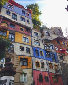 Backpacking Europe in 21 days.  Fourth stop - Vienna, Austria  Hundertwasserhaus. Life must be colorful living in these apartments. A wonder to see when in Vienna. 📸 by: @iamchristinetaj ... ... #wigglefoot #backpackingeurope #beautifuldestinations #lonelyplanet #canon #interraileu #europeroamers #vienna #vienn #travel #austria #discoveraustria #hundertwasserhaus