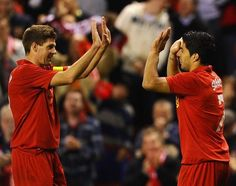 Steven Gerrard of Liverpool congratulates Luis Suarez on scoring during the UEFA Europa League playoff round second leg between Liverpool and Hearts. Liverpool Captain, Liverpool Team, Steven Gerrard, Intresting News, Transfer Window, Heart Pictures, World Football, Automotive News, Europa League