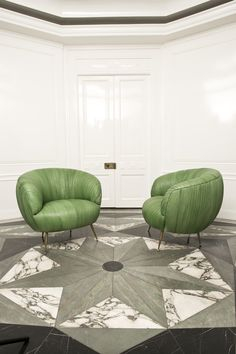 KELLY WEARSTLER | GREEN LEATHER SOUFFLE CHAIR. Ruched leather detail. Full-finish, vegetable dyed lambskin. This exquisitely detailed and luxurious chair sits on tapered legs of solid cast bronze.