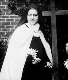 """St. Therese of Lisieux, thank you for the rose.--""""He does not come down from Heaven each day to stay in the gold ciborium. He comes down to find another Heaven He cherishes infinitely more than the first, the Heaven of our souls, made in His image, living temples of the Most Blessed Trinity!"""" — St. Therese of Lisieux, p. 31 AN EXCERPT FROM Meditations with the Little Flowe"""
