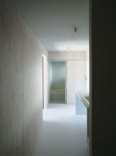 Most of the house is oriented towardthe glass curtain wall overlooking the town of Odawara, save for private areas like the shared bathroom.