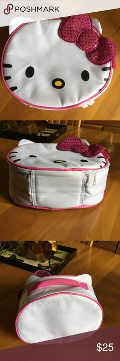 Hello Kitty Insulated Lunch Tote Hello Kitty Insulated Lunch Tote in the shape of Hello Kitty Face. In excellent condition preloved, used a few times. Easy to clean. Offers welcome and all purchases receive free gift 🎁! Hello Kitty Bags